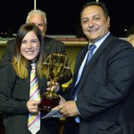 Trainer Brooke Ennis is presented with the Hume Cup