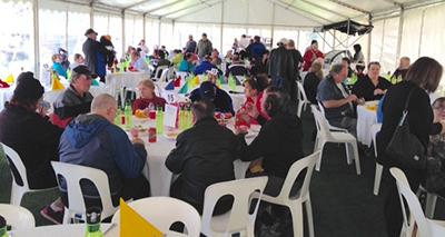 Community groups at The Great Chase Grand Final marquee at The Meadows.
